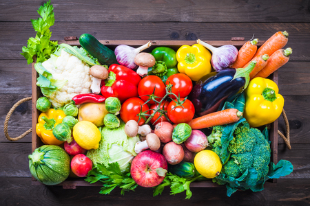 58901859 - vegetables and fruits in wooden box on rustic background.